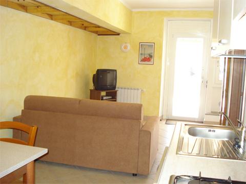 Foto van Appartement  Ortensia_secondo_Acquaseria_31_Wohnraum