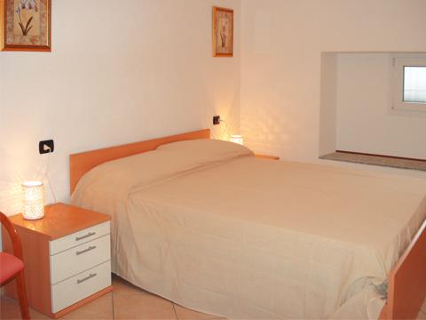Foto van Appartement  Ortensia_secondo_Acquaseria_40_Doppelbett-Schlafzimmer
