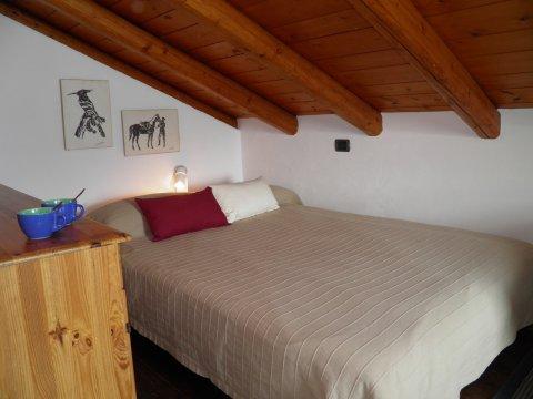 Bilder von Comer See Ferienwohnung Ribolla_Gravedona_40_Doppelbett-Schlafzimmer